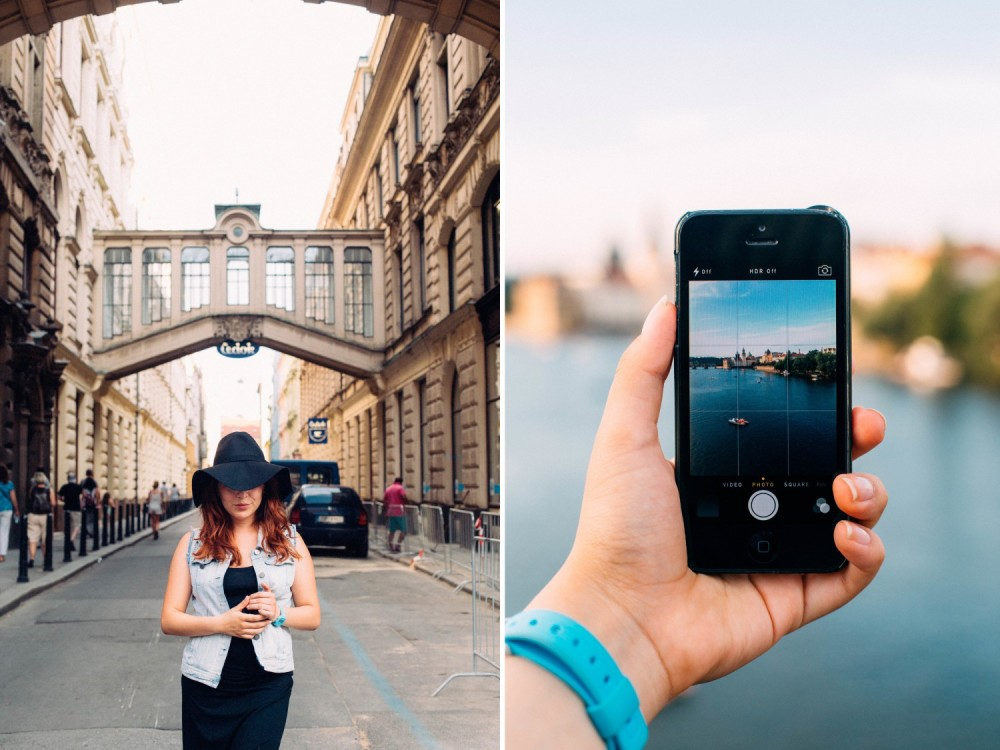 Hand holding Iphone in Prague